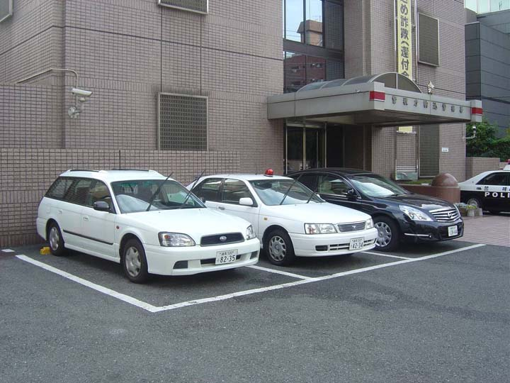 Tokyo police department vehicles at station