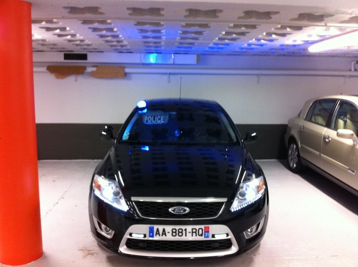 Ford police car in French parliament car park.