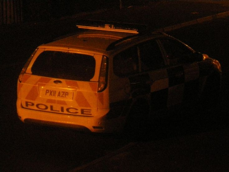 Cumbria Constabulary police car at night