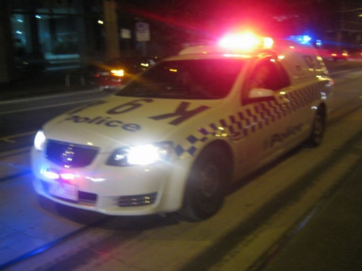 Victoria Police Holden Divi Van unit K94 at night.