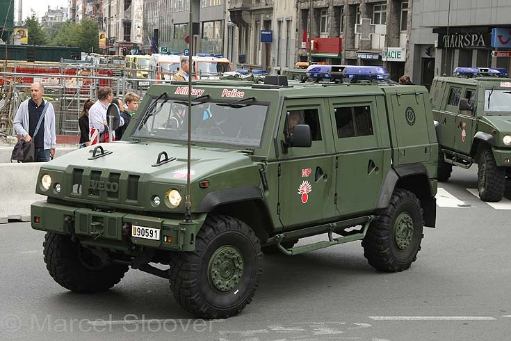 File:A US Army Military Policeman (MP) uses his vehicle to block ...