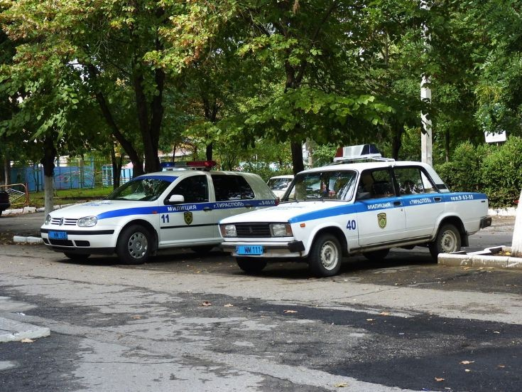VW Golf and Lada Patrol Cars